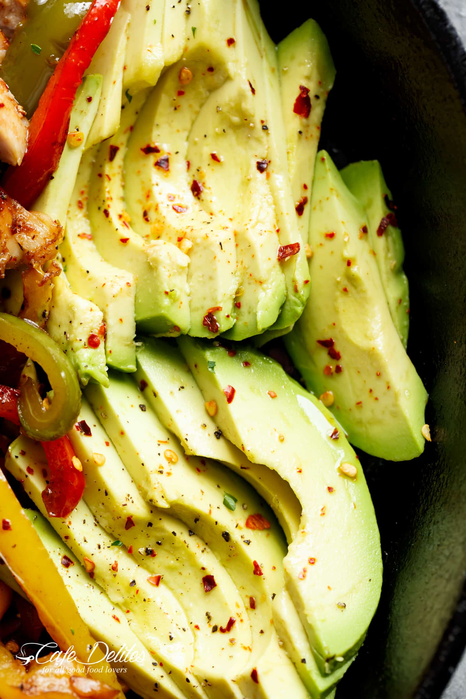 The BEST chicken fajitas topping avocado slices guacamole | cafedelites.com