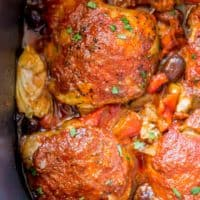Cooked Chicken in Slow cooker with olives and artichokes.