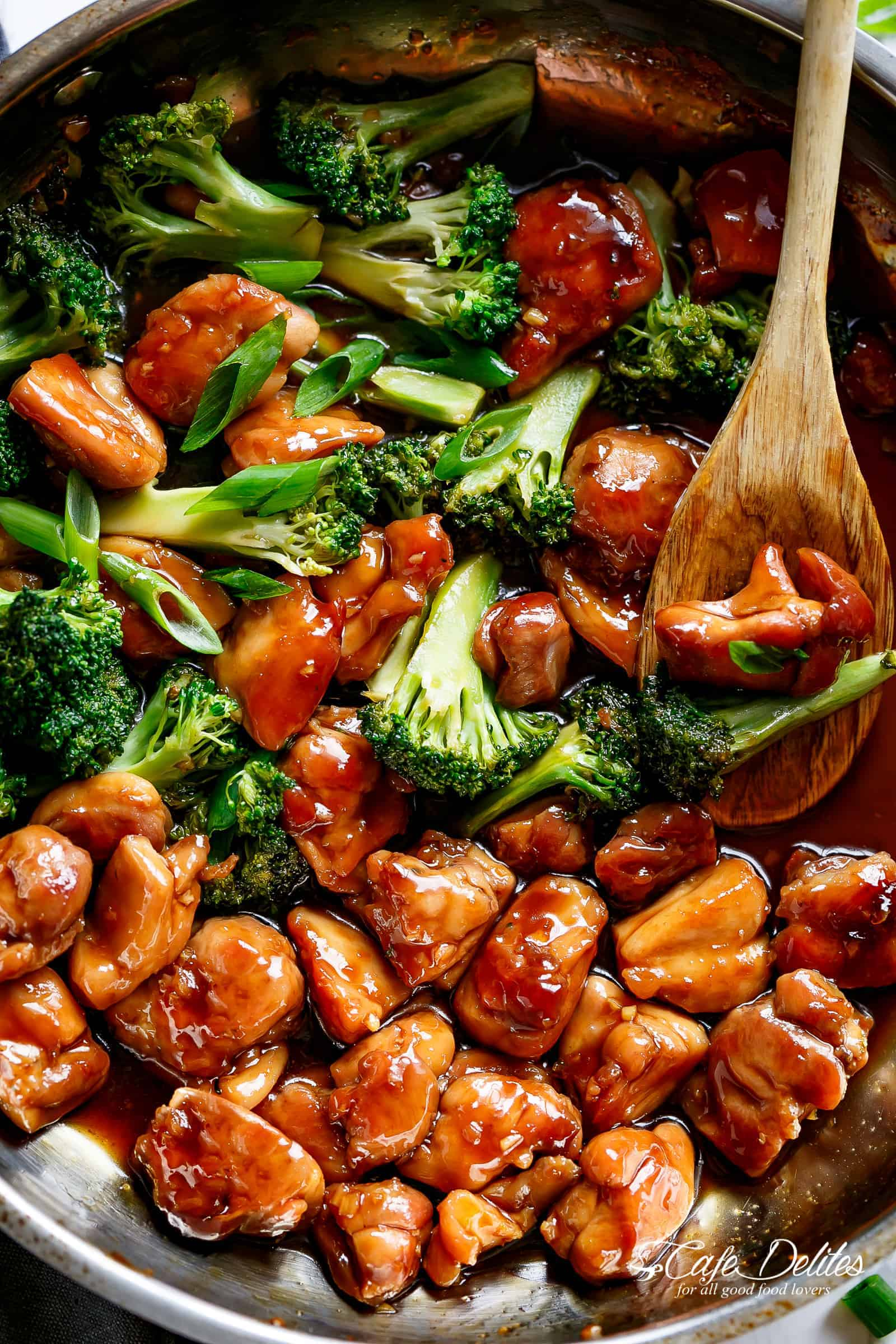 Teriyaki Chicken with broccoli is a super easy chicken recipe cooked in 10-minutes with no marinading needed! Crispy and juicy skinless chicken thighs stir-fried and swimming in a beautiful flavoured homemade teriyaki sauce. | cafedelites.com