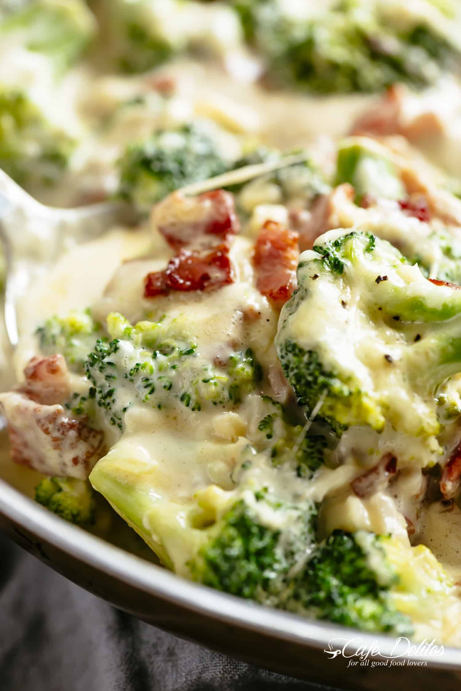 Broccoli Casserole baked in a cheesy creamy parmesan garlic sauce topped with bubbling mozzarella! Keto approved and low carb!   cafedelites.com
