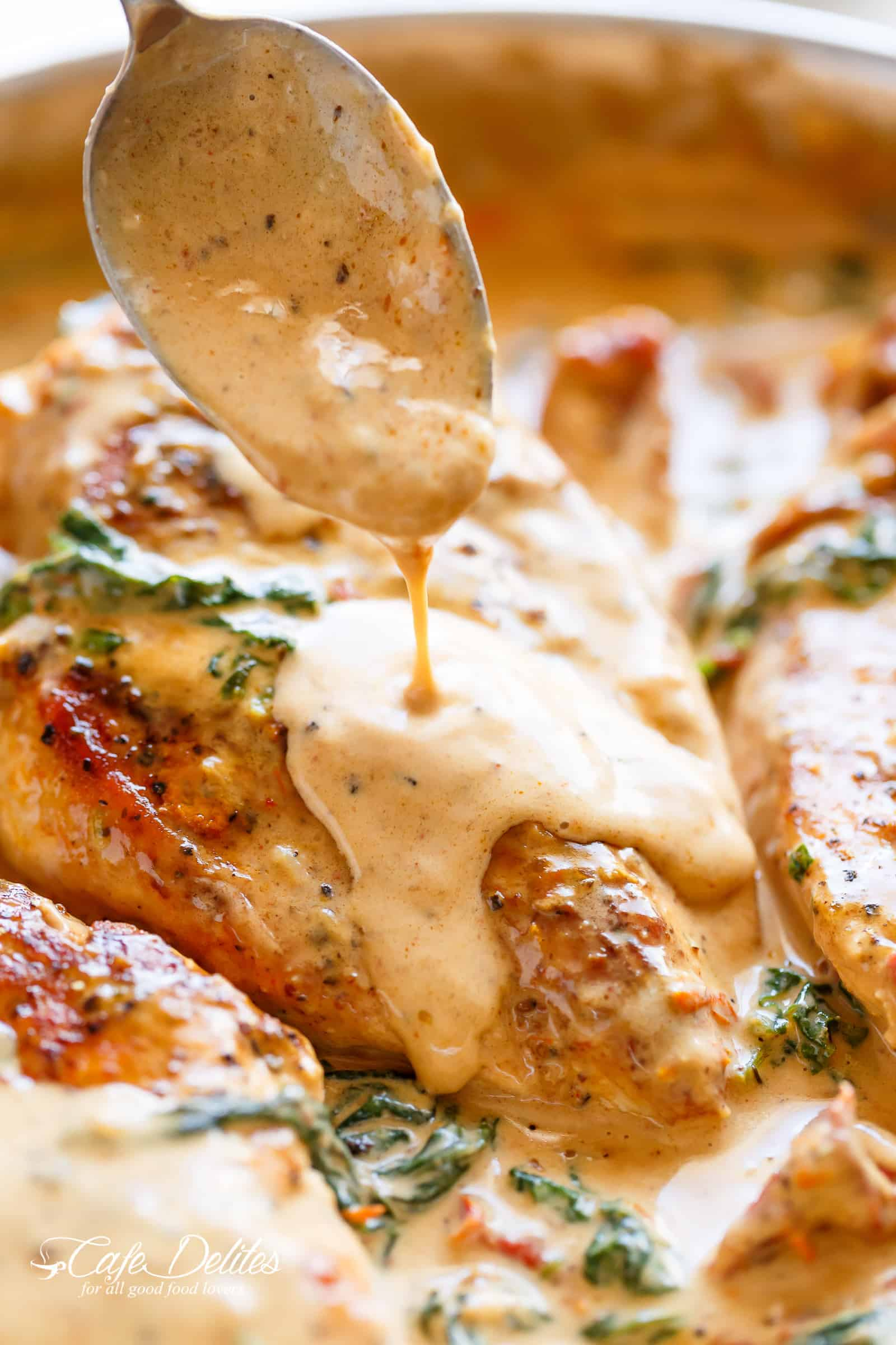 Chicken with Creamy Sun Dried Tomato Parmesan Sauce is PACKED with flavour in a thick and creamy Dijon and parmesan cream sauce.   cafedelites.com