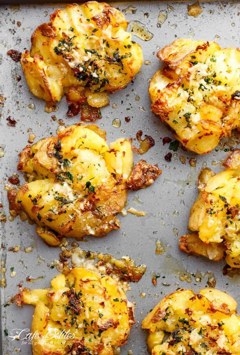 Crispy Garlic Butter Parmesan Smashed Potatoes are just like buttery and garlicky French fries or crispy hot chips. | http://cafedelites.com