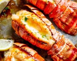 Broiled Lobster Tails with Honey Garlic Butter White Wine Sauce is a fancy, classy and best of all EASY to make recipe. Ready in under 20 minutes, let the oven do all the cooking for you! Full of flavour, there's no need to go to a restaurant for chef-tasting, slightly charred lobster tails! | cafedelites.com
