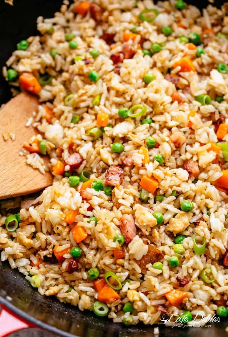 Fried Rice with crispy bacon and fluffy eggs is better than take out and so easy to make! Why go out when you can have the best fried rice right at home! Just like Chinese take out fried rice. Perfect for when you have leftover rice OR make it quick from scratch with a few tricks! | cafedelites.com