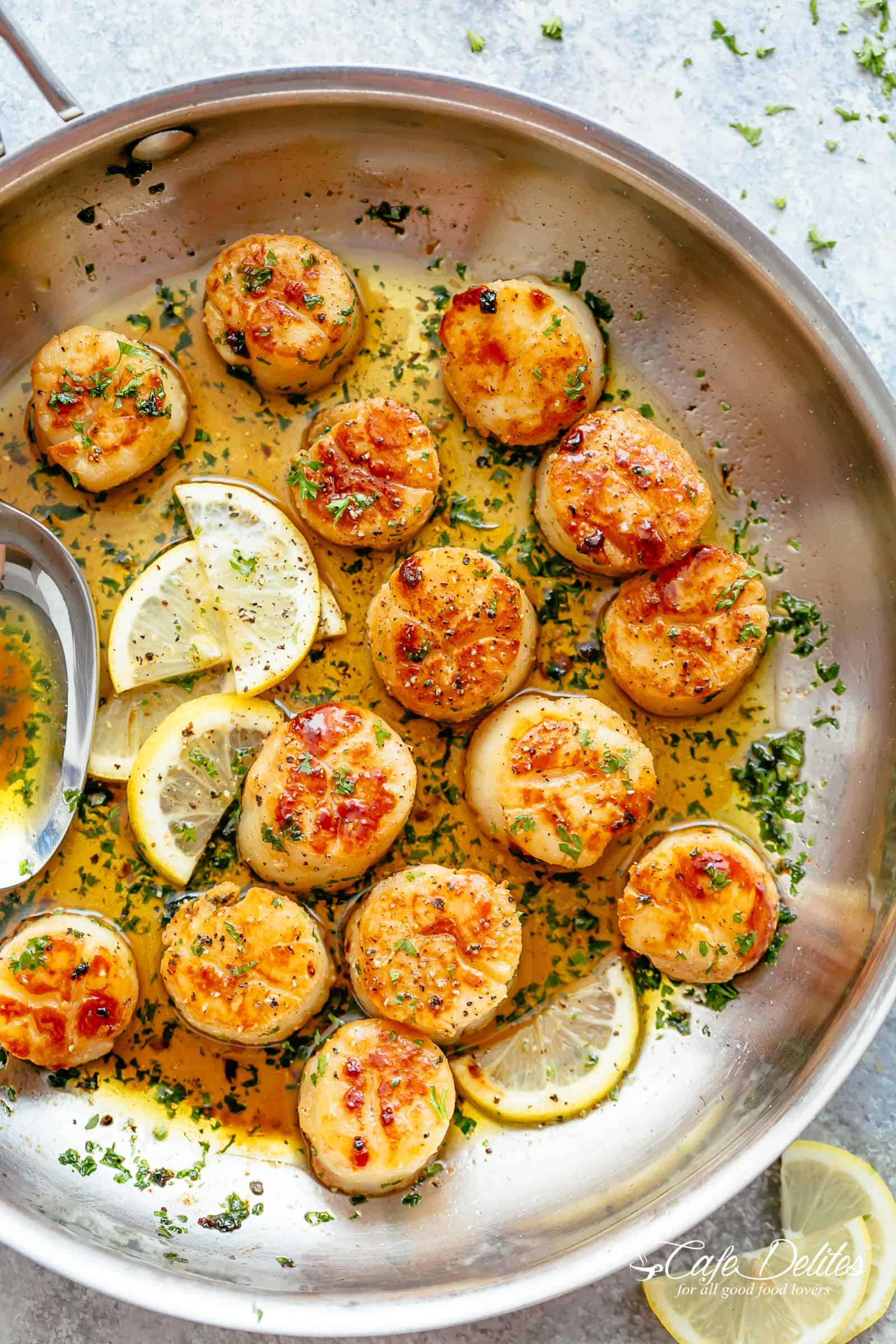 Have Crispy Lemon Garlic Butter Scallops on your table in less than 10 minutes, coated in a deliciously silky lemon garlic butter sauce! Cheaper than going out to a restaurant and just as good as chef made scallops! They are the ultimate treat! | cafedelites.com