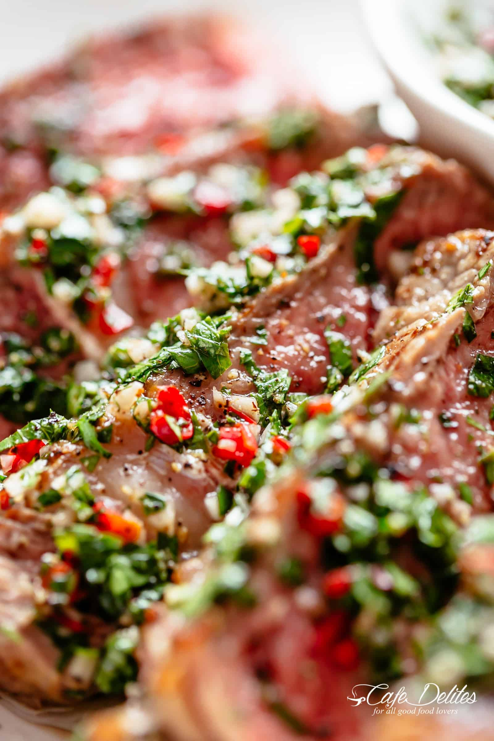 Chimichurri is the most delicious silky condiment that drips over your steak, chicken or fish. Super easy to make and tastes incredible! | cafedelites.com