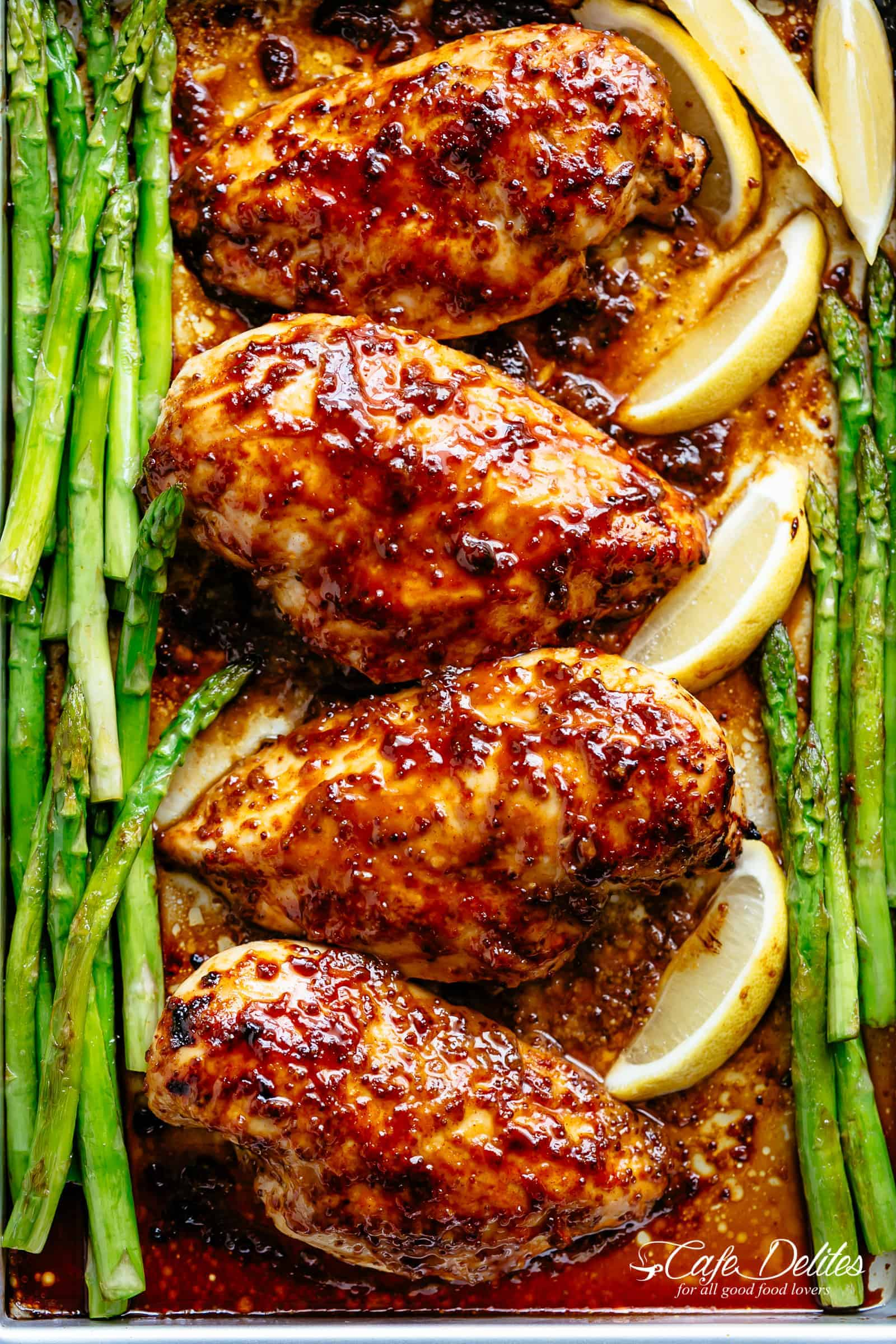 Tender and juicy Baked Chicken Breasts with a delicious honey mustard sauce with a kick of garlic and lemon juice takes only minutes to make! Baked Chicken couldn't be any easier to prepare for a quick and easy dinner idea! This will become your new favourite chicken breast recipe! | cafedelites.com