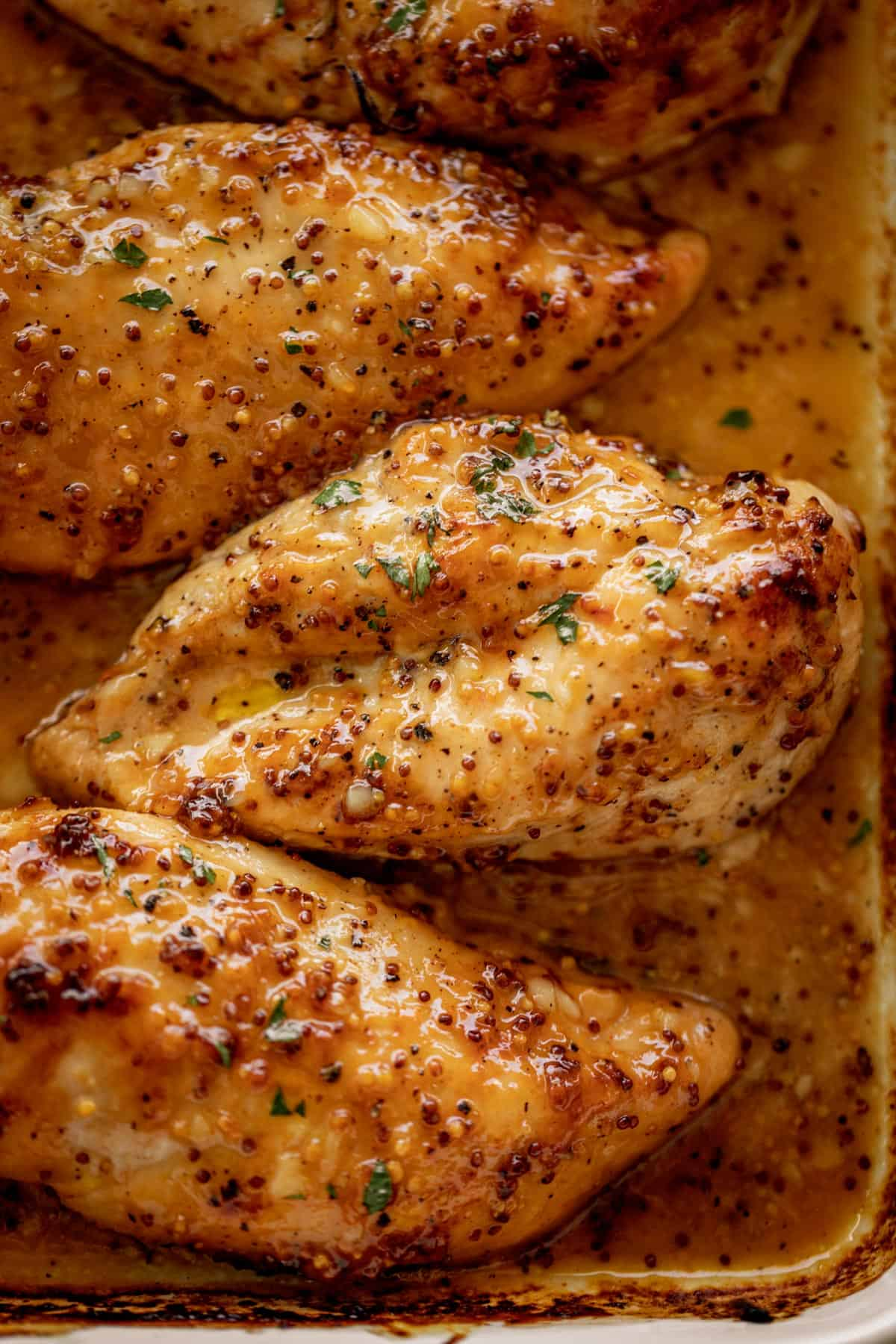 Tender and juicy Baked Chicken Breasts with a delicious honey mustard sauce with a kick of garlic and lemon juice takes only minutes to make! Baked Chicken couldn't be any easier to prepare for a quick and easy dinner idea! This will become your new favourite chicken breast recipe. | cafedelites.com