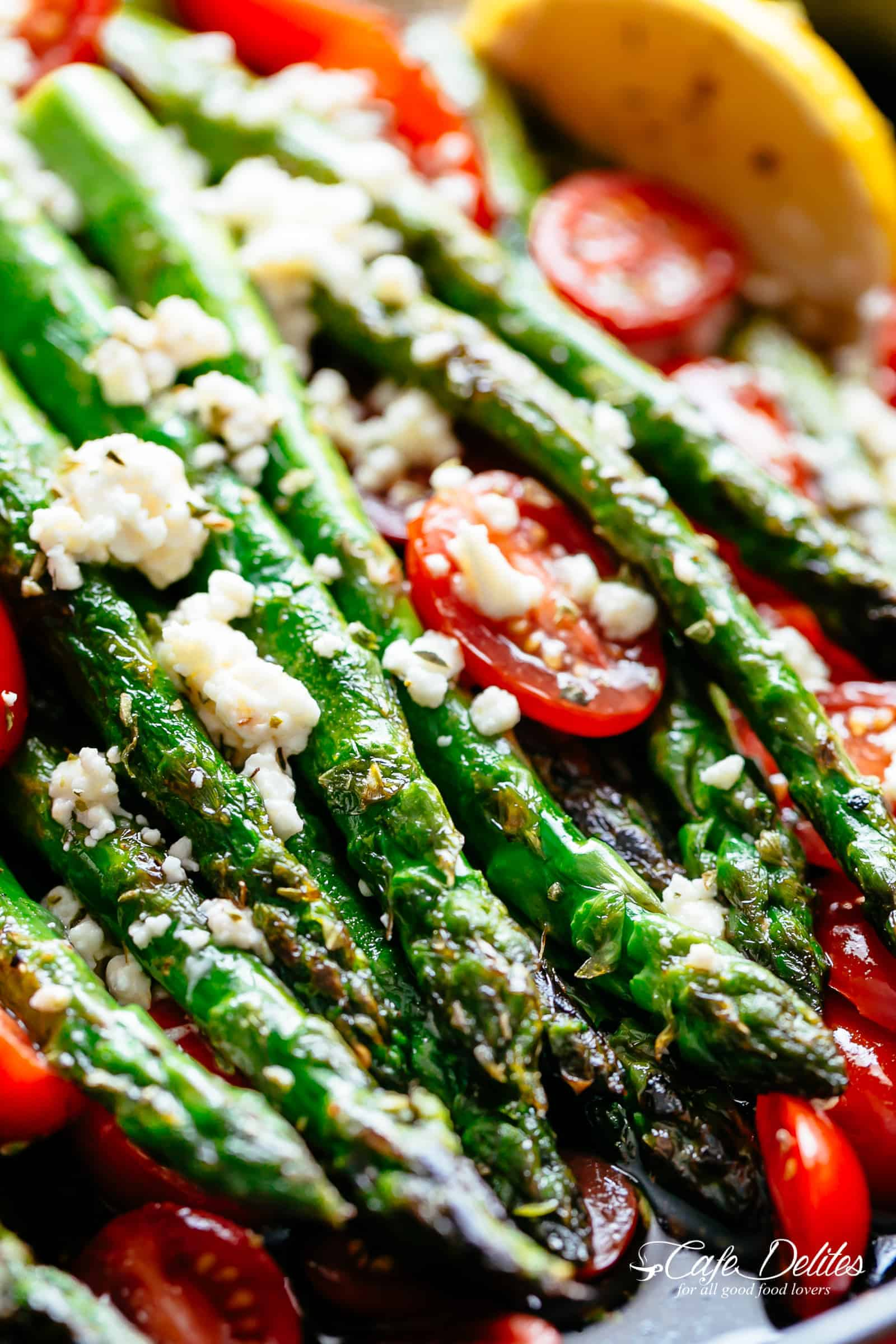 Lemon Garlic Asparagus topped feta cheese, tomatoes and drizzled with Mediterranean flavours makes the perfect side dish! | cafedelites.com