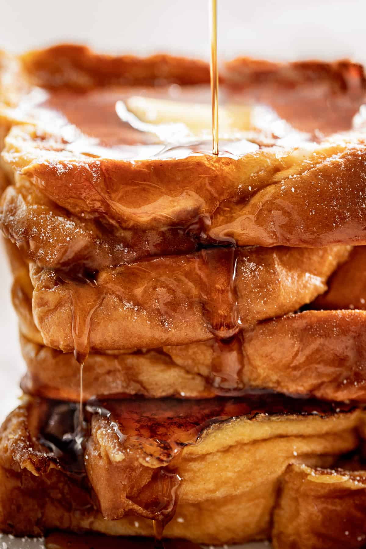 The Best French Toast drizzled with maple syrup