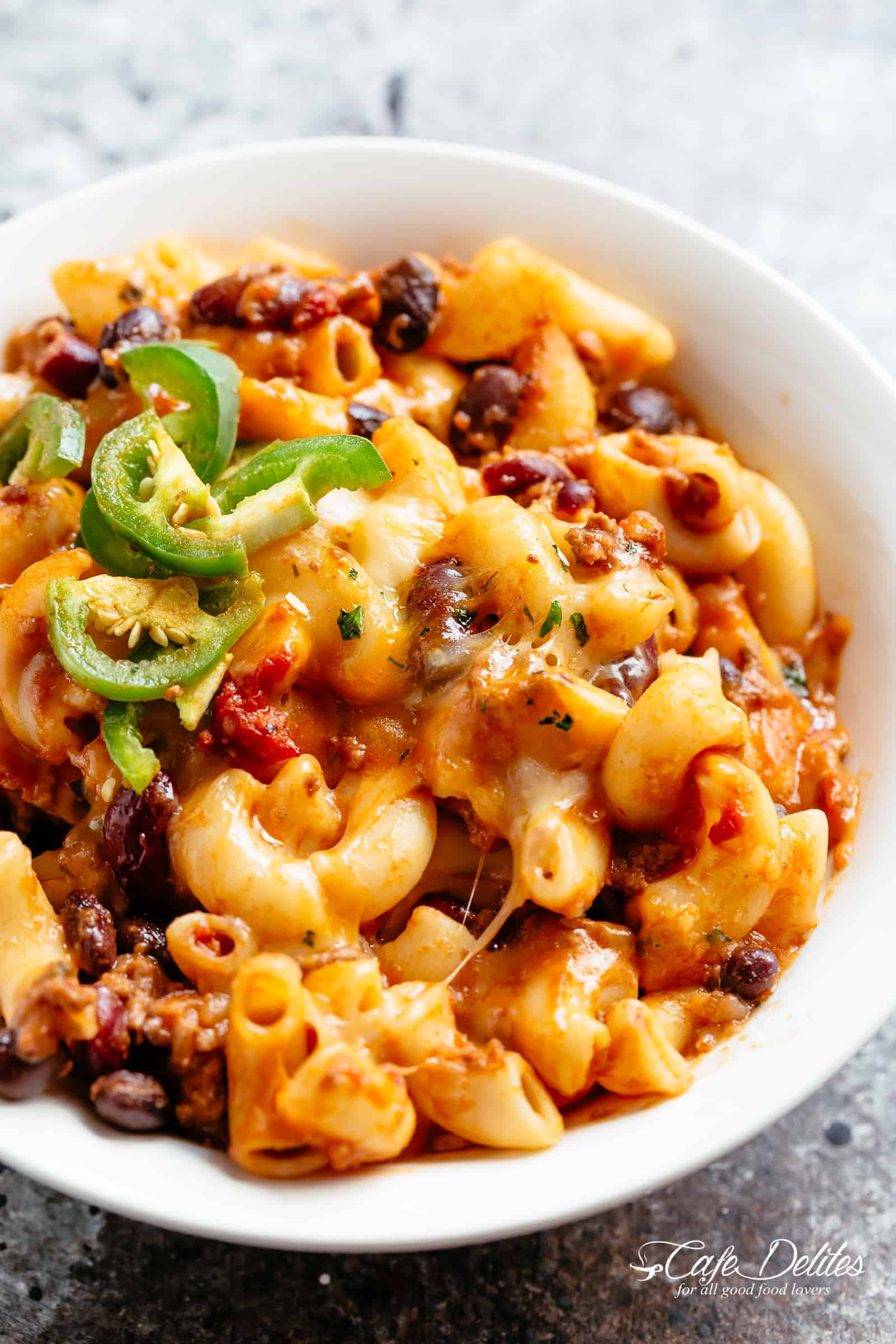Chili Mac and Cheese with beans is the ultimate mash up of TWO favourites -- Chili PLUS Mac and Cheese! Using leftover chili OR chili made from scratch, this casserole is ready and on the table in less than 30 minutes! Incredible flavours that the whole family will go crazy for! | cafedelites.com
