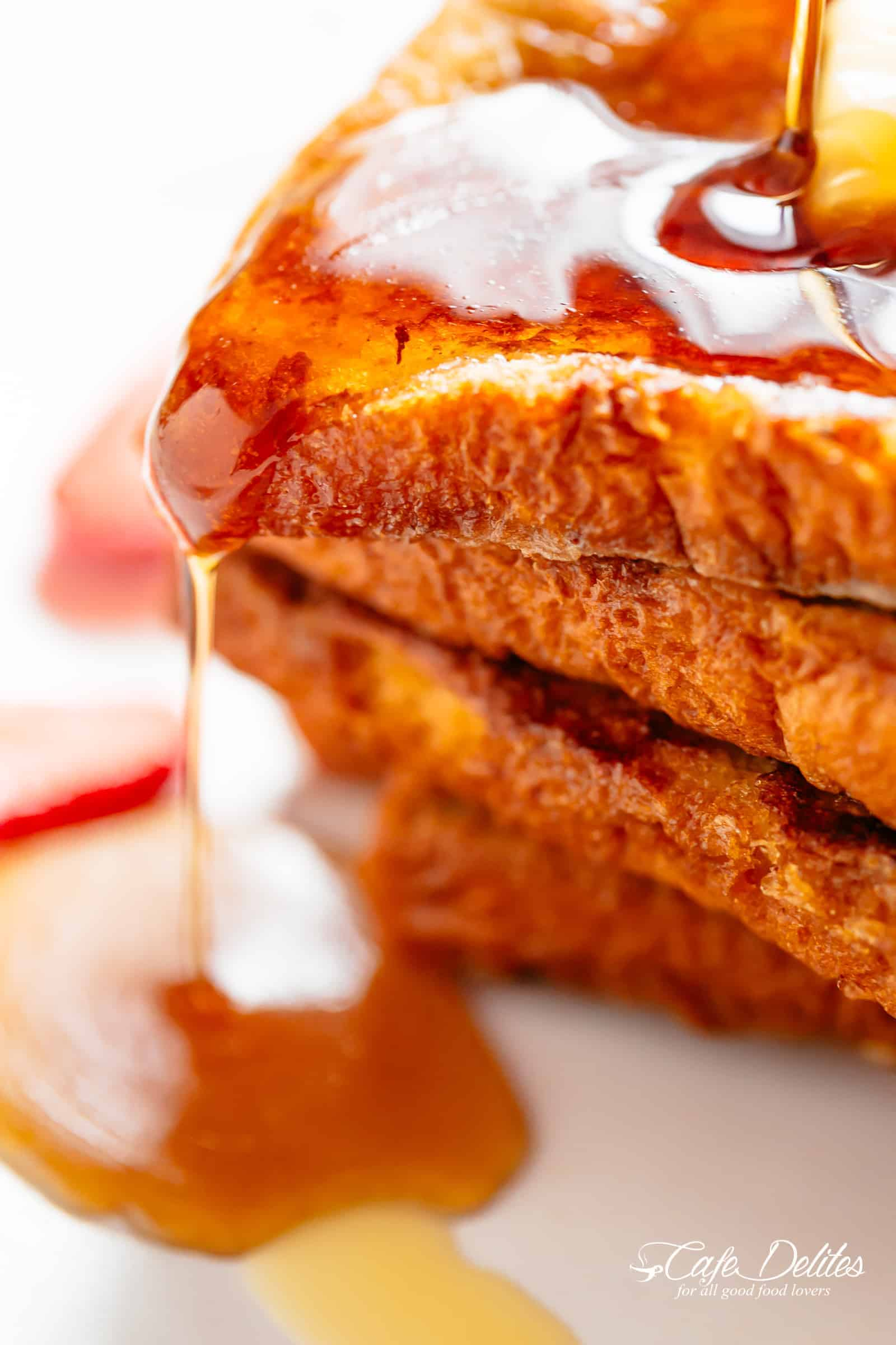 The Best French Toast is super easy to make with the perfect balance of flavours soaked into brioche slices! With a hint of vanilla and cinnamon, a touch of sweetness, and crispy pan fried edges, this is one French Toast recipe the whole family goes crazy for | cafedelites.com