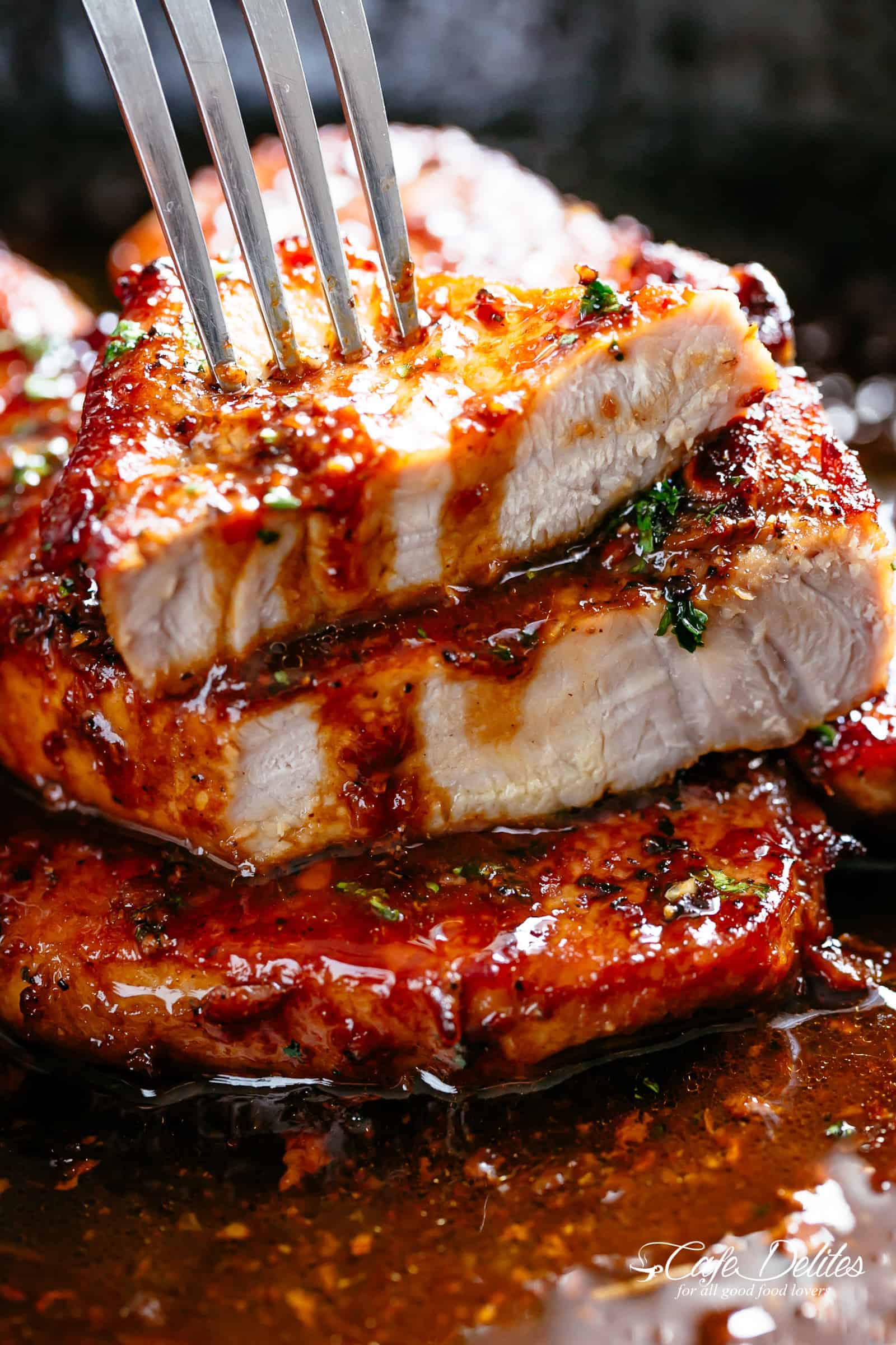 Easy Honey Garlic Pork Chops made simple, with the most amazing and addictive 4-ingredient honey garlic sauce that is so good you'll want it on everything! | cafedelites.com