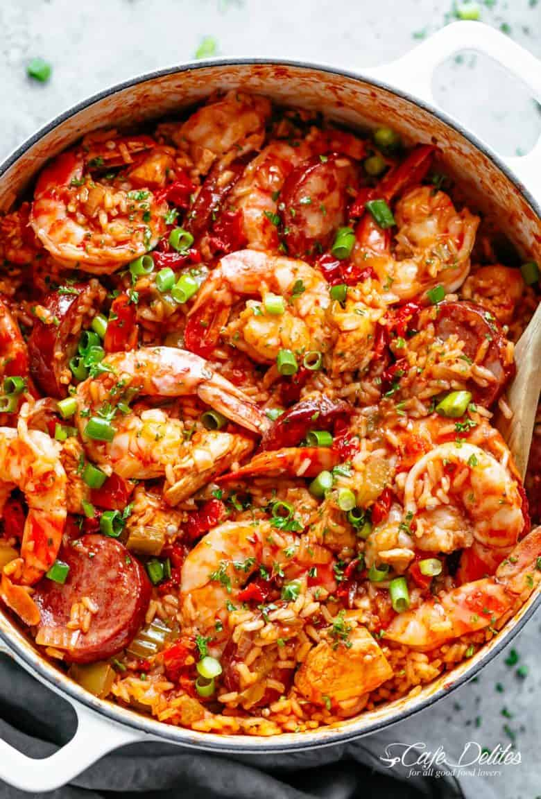 An authentic Creole Jambalaya recipe! A delicious one-pot meal coming to you from New Orleans is pure comfort food filled to the brim with chicken, shrimp, andouille sausage, rice, seasonings, spices and incredible flavours! Ready and on the table in 45 minutes! | cafedelites.com