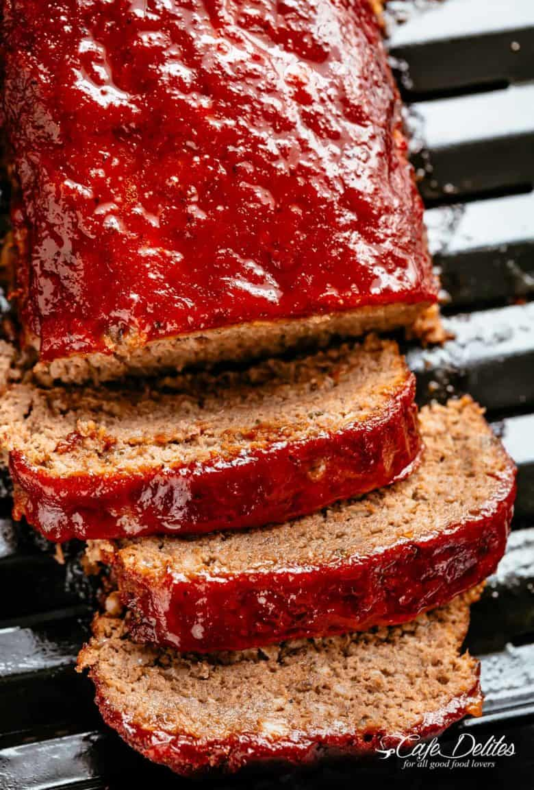 How to make the best tender and juicy Meatloaf with a delicious shiny glaze! Cheap, easy and quick to prepare, let the oven do all the work for you! The whole family goes crazy over each slice of this meatloaf recipe. PLUS... take advantage of leftovers and turn them into the best meatloaf sandwiches! | cafedelites.com
