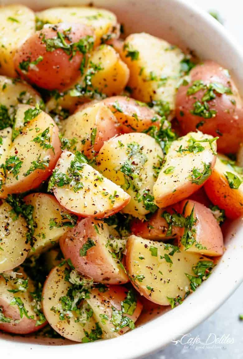 Garlicky Herb Red Potato Salad is ridiculously easy to make and packed with flavour! Slathered in the best and most delicious herb dressing with olive oil, a slight tang of vinegar, a kick of garlic and the most incredible flavours of fresh herbs, this Potato Salad Recipe will be a hit on your dinner table! | cafedelites.com