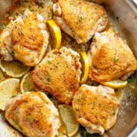 Roast Lemon Chicken thighs with crispy skin pan, seared then oven baked for tender and juicy chicken full of flavour! Your new favourite chicken recipe is here! With a kick of garlic and a touch of herbs, simple to make with minimal ingredients and maximum flavour!   cafedelites.com