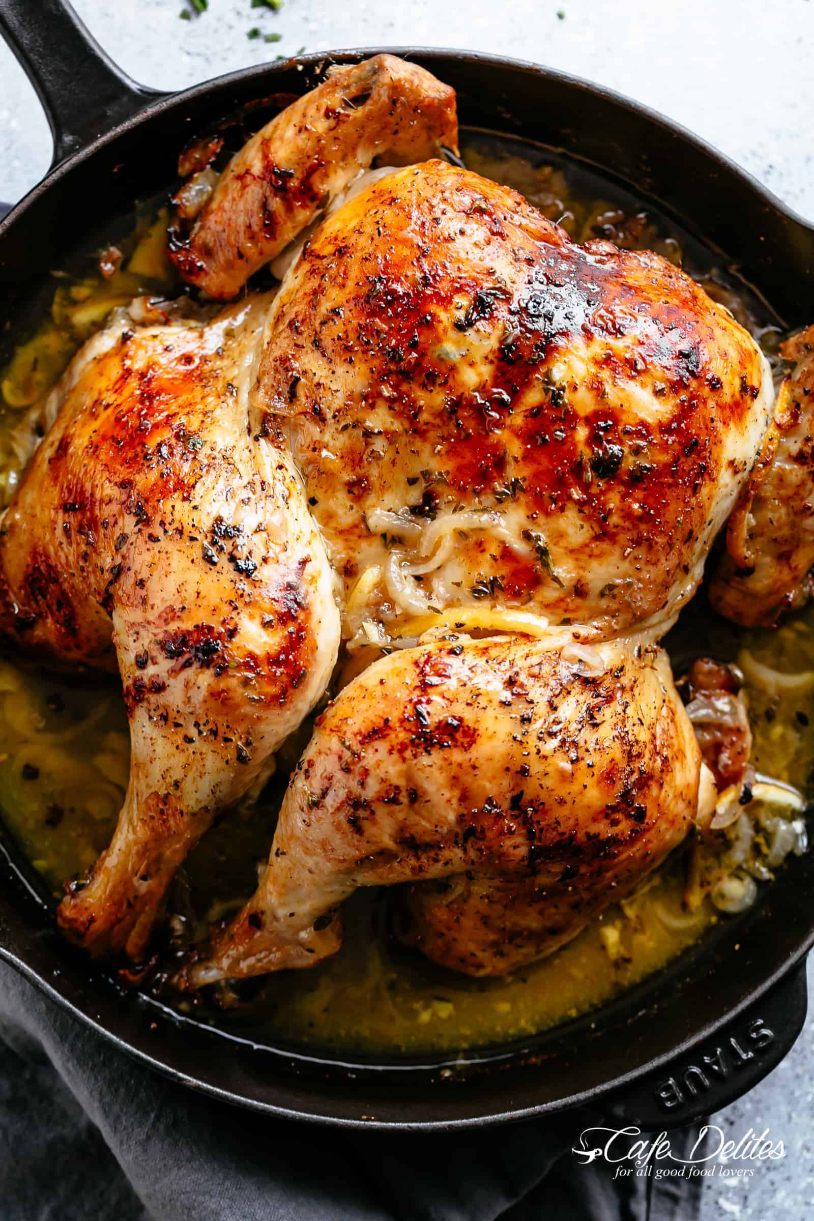 Tender and juicy Lemon Garlic Roast Chicken with crispy, rich and flavourful skin, so much flavour and easy to find ingredients! Garlic, onions, lemons, olive oil, fresh herbs and a splash of white wine (optional) make this one amazing roast chicken recipe! You'll be so surprised at how moist the meat is! | cafedelites.com