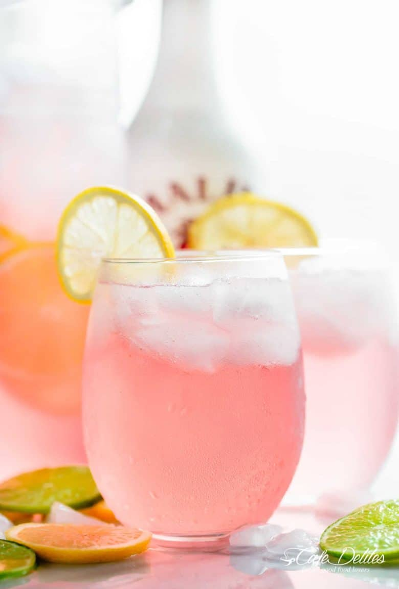 Pink Vodka Lemonade with a splash of Malibu and lime juice to get your party started! Easy to make and refreshing! | cafedelites.com