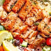 Avocado Salmon Salad with an incredible lemon herb Mediterranean dressing! Loaded with cucumber, olives, tomatoes and feta cheese! | cafedelites.com