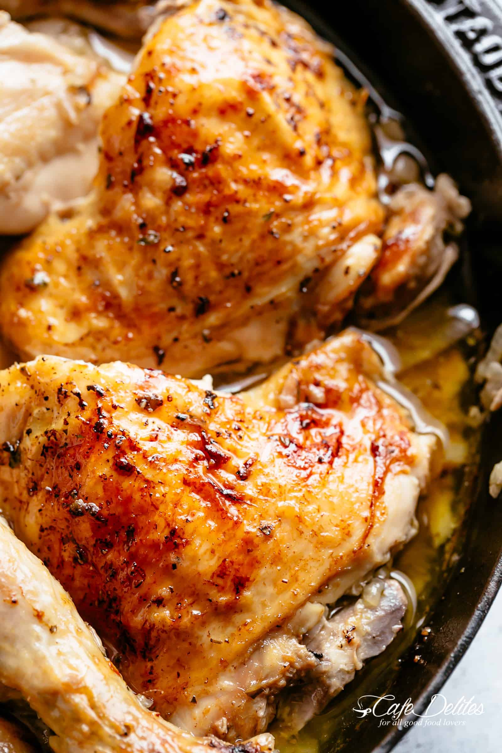 Tender and juicy Lemon Garlic Roast Chicken with crispy, rich and flavourful skin, so much flavour and easy to find ingredients! Garlic, onions, lemons, olive oil, fresh herbs and a splash of white wine make this one amazing roast chicken recipe! | cafedelites.com