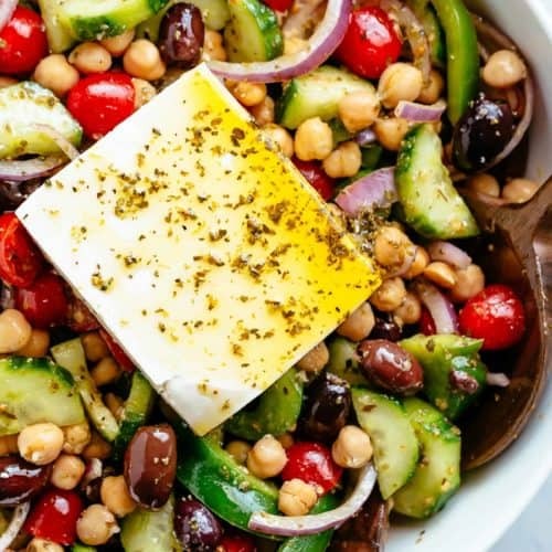 Greek Chickpea Salad with an authentic greek salad dressing is a favourite salad to serve as a main OR as a side! Healthy and filling! | cafedelites.com