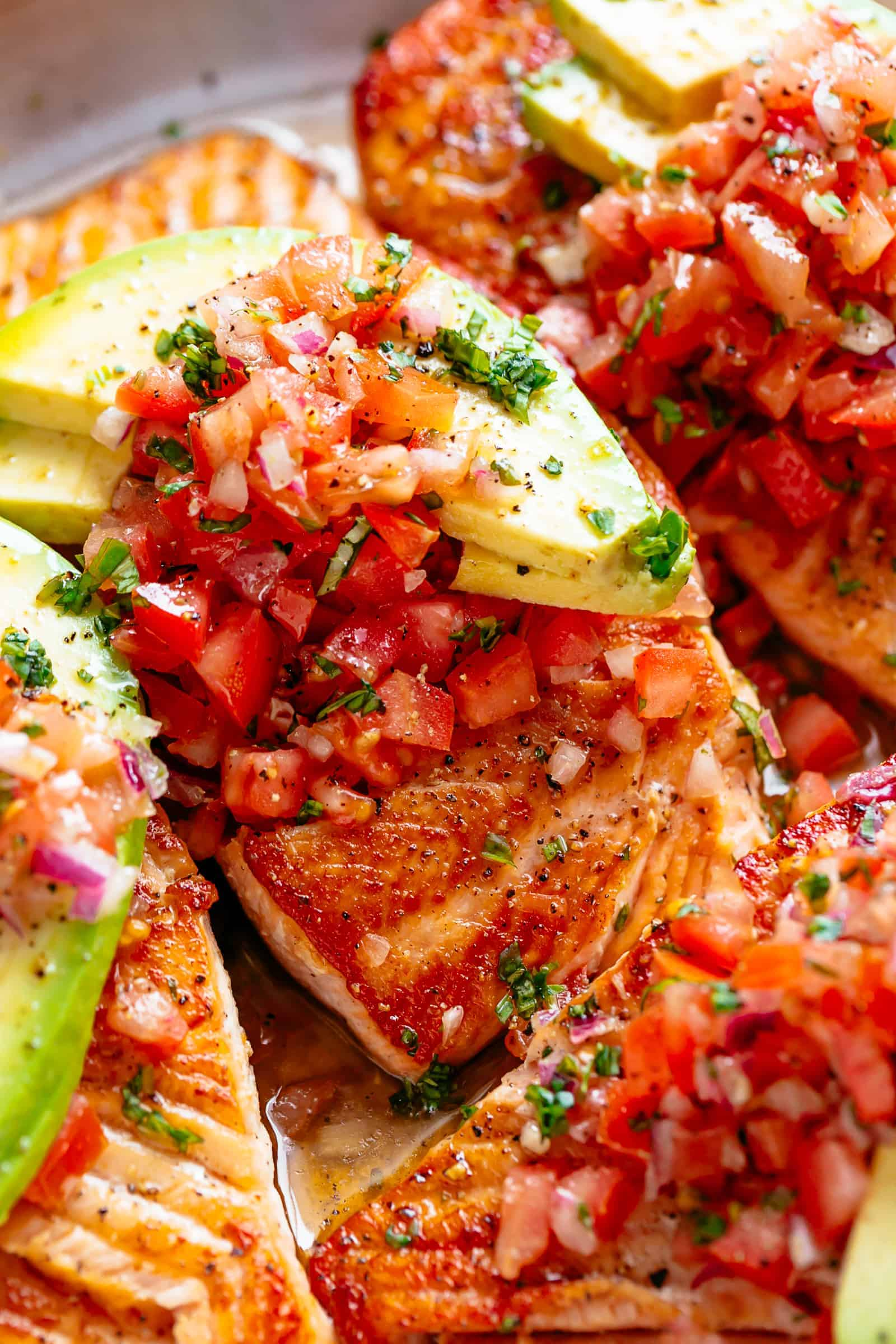 Pan Seared Salmon with tomato salsa and avocado! | cafedelites.com