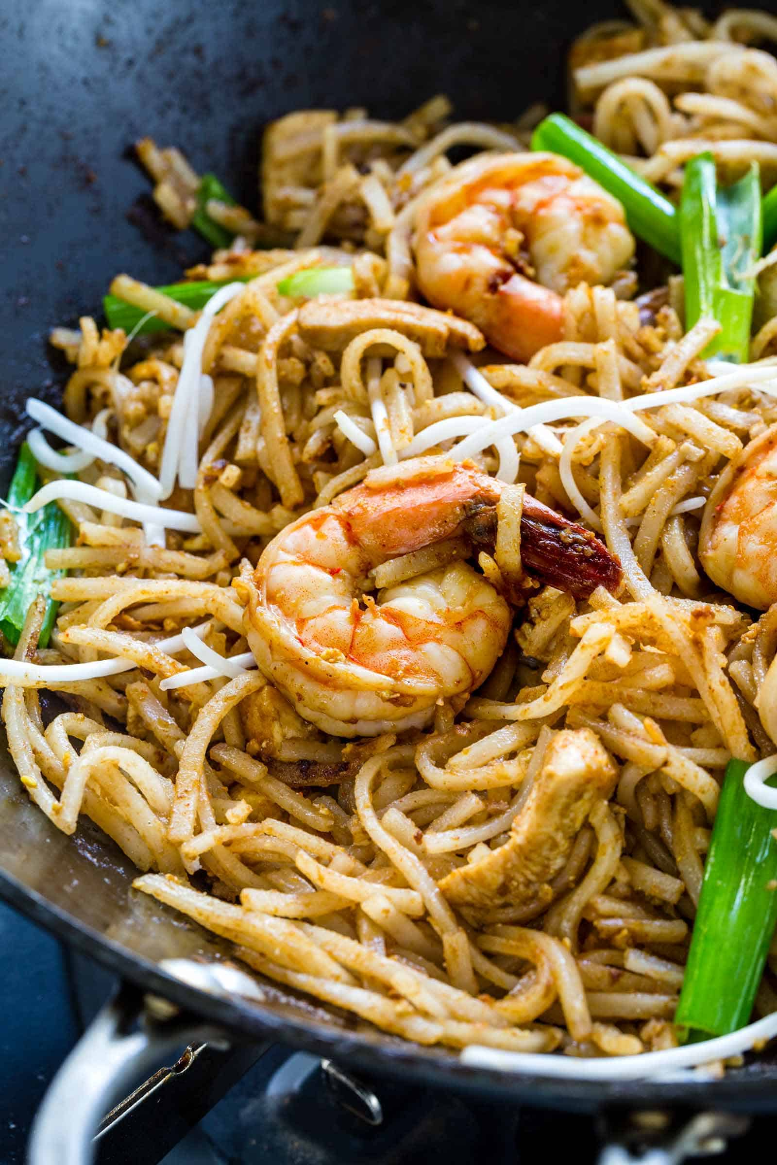 shrimp and chicken pad thai in a wok