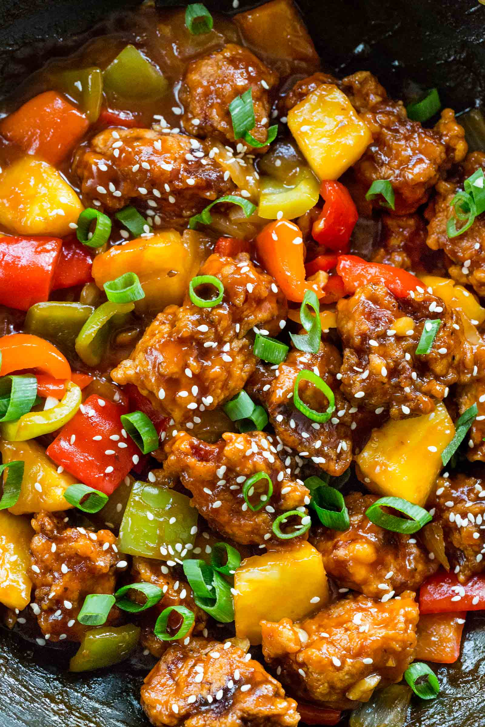 sweet and sour pork with vegetables in a wok