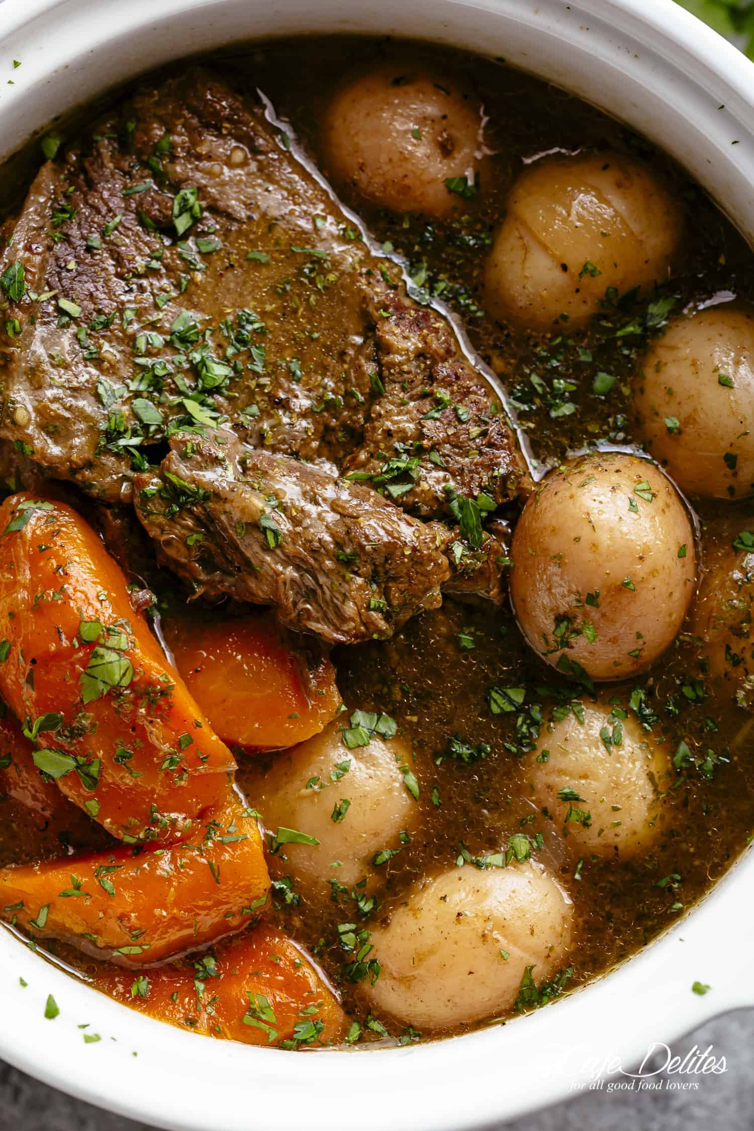 Pot Roast is perfect for an easy weekday or weekend dinner! Minimal work and maximum taste happens underneath that lid! | cafedelites.com