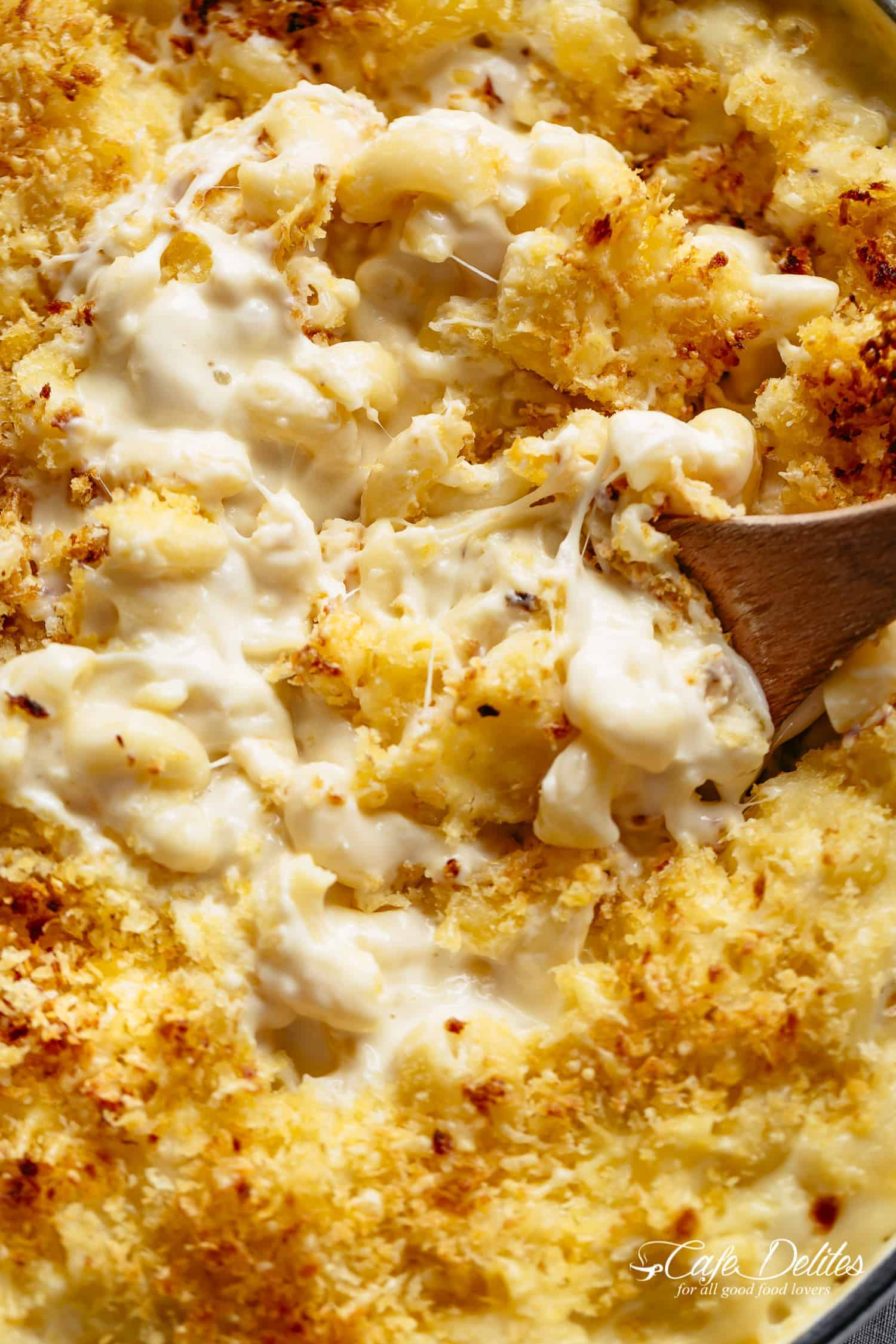 Mac And Cheese is better than the original! A creamy garlic parmesan cheese sauce coats your macaroni, topped with parmesan fried bread crumbs, while saving some calories! | https://cafedelites.com