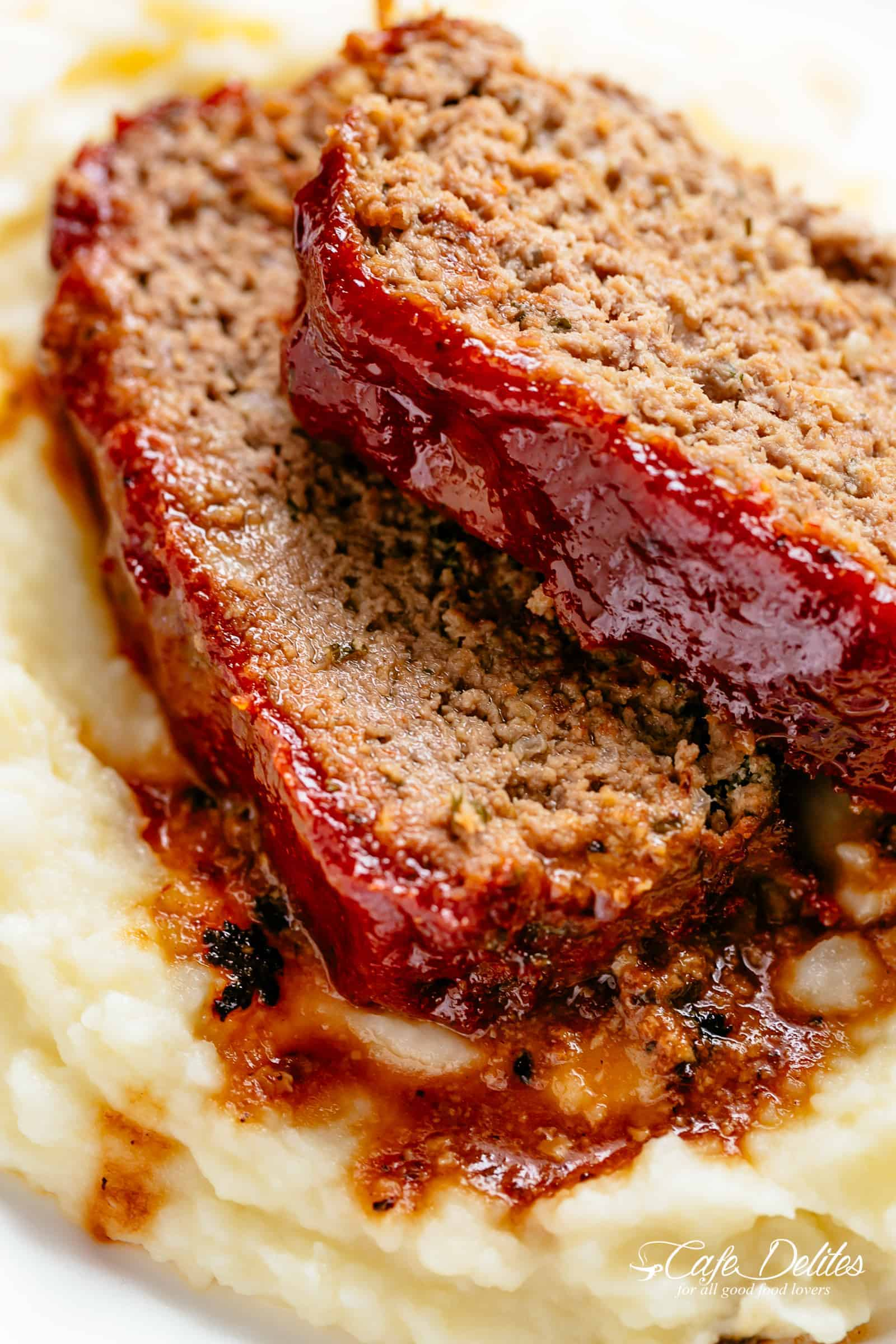Tender and juicy Meatloaf with a delicious shiny glaze! Cheap, easy and quick to prepare, let the oven do all the work for you! The whole family goes crazy over each slice of this meatloaf recipe. | cafedelites.com