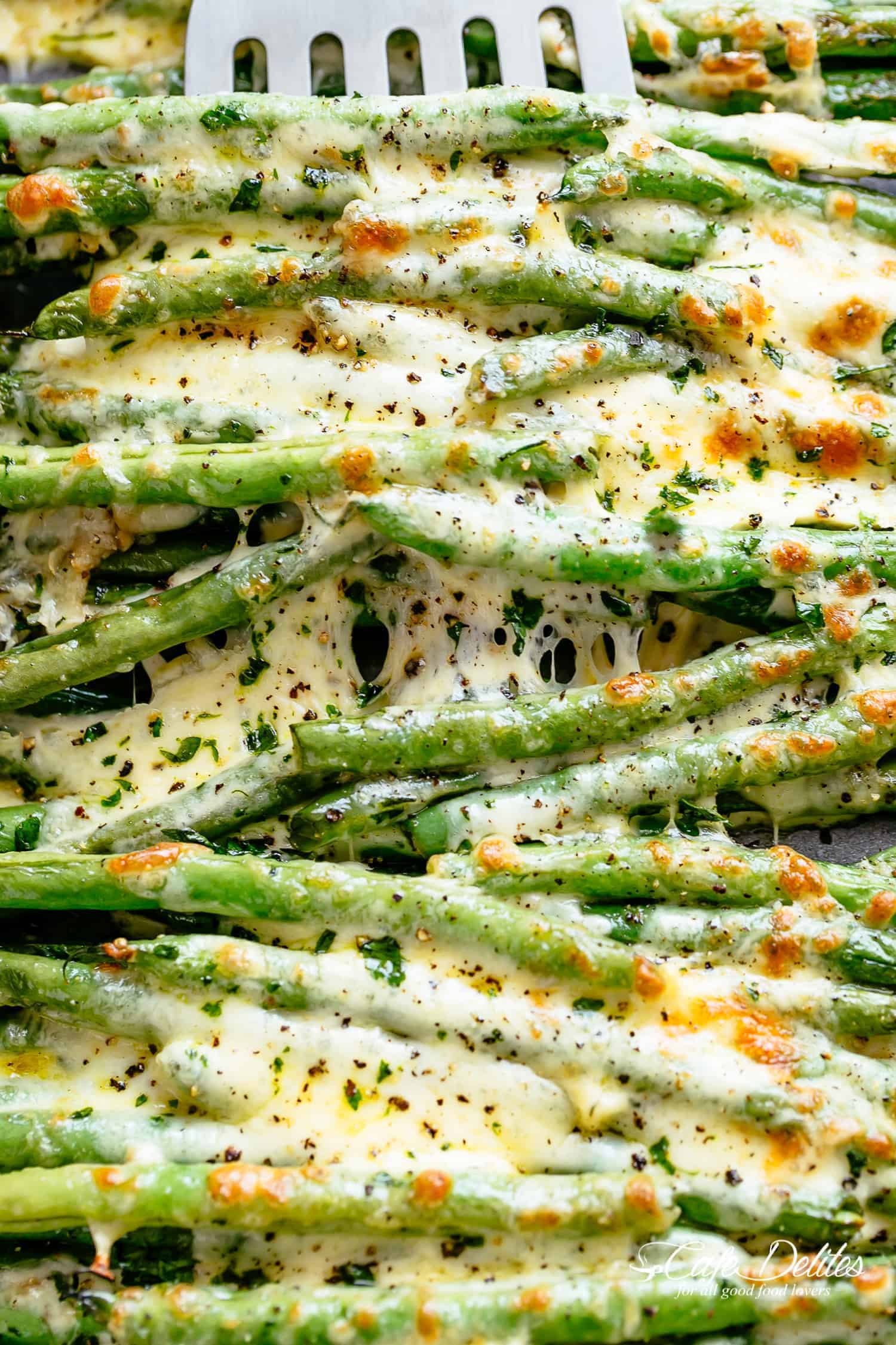 Melted cheese on roasted green beans