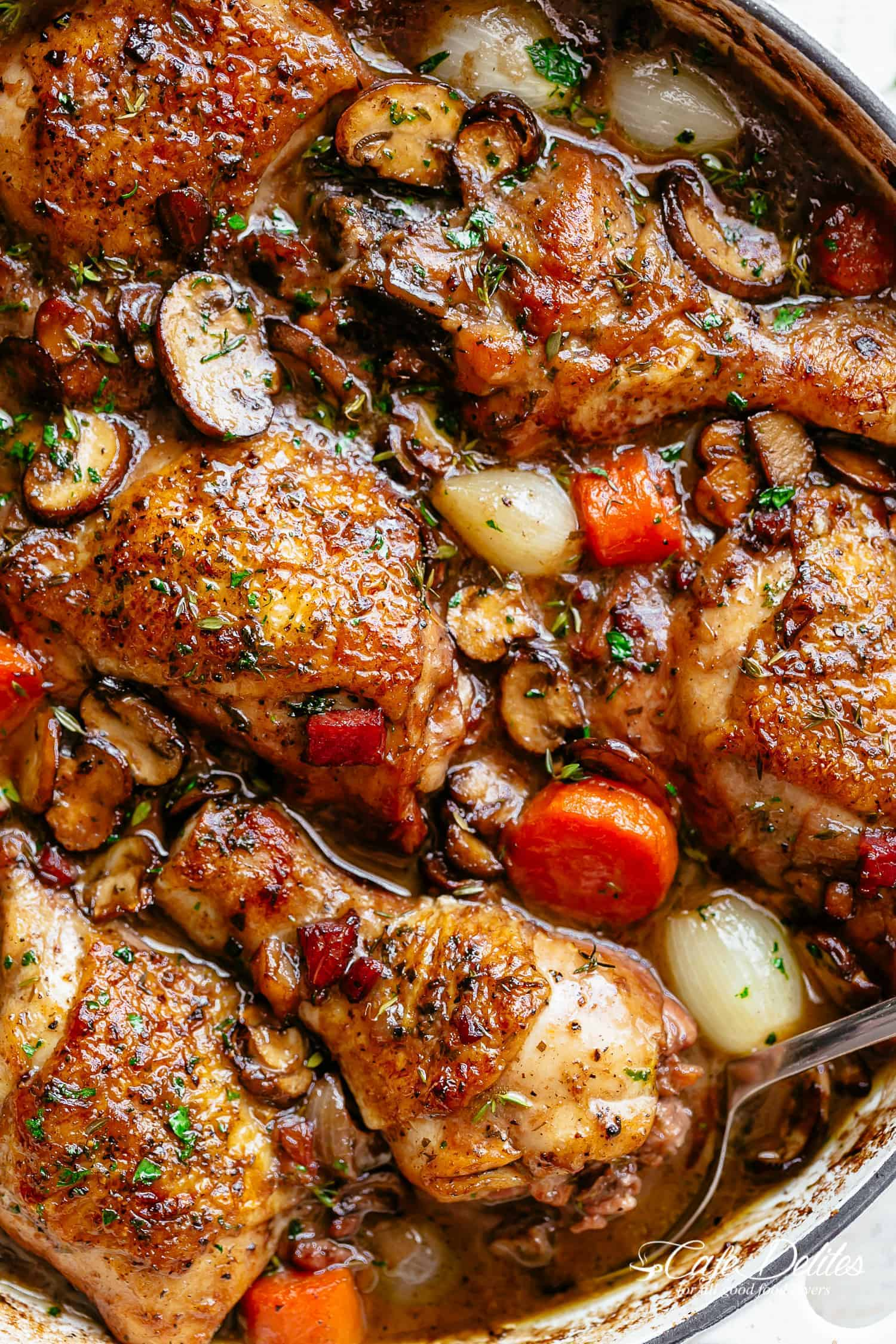 Coq Au Vin, or chicken in wine, is a popular classic French Chicken Stew made easy with crispy chicken pieces!