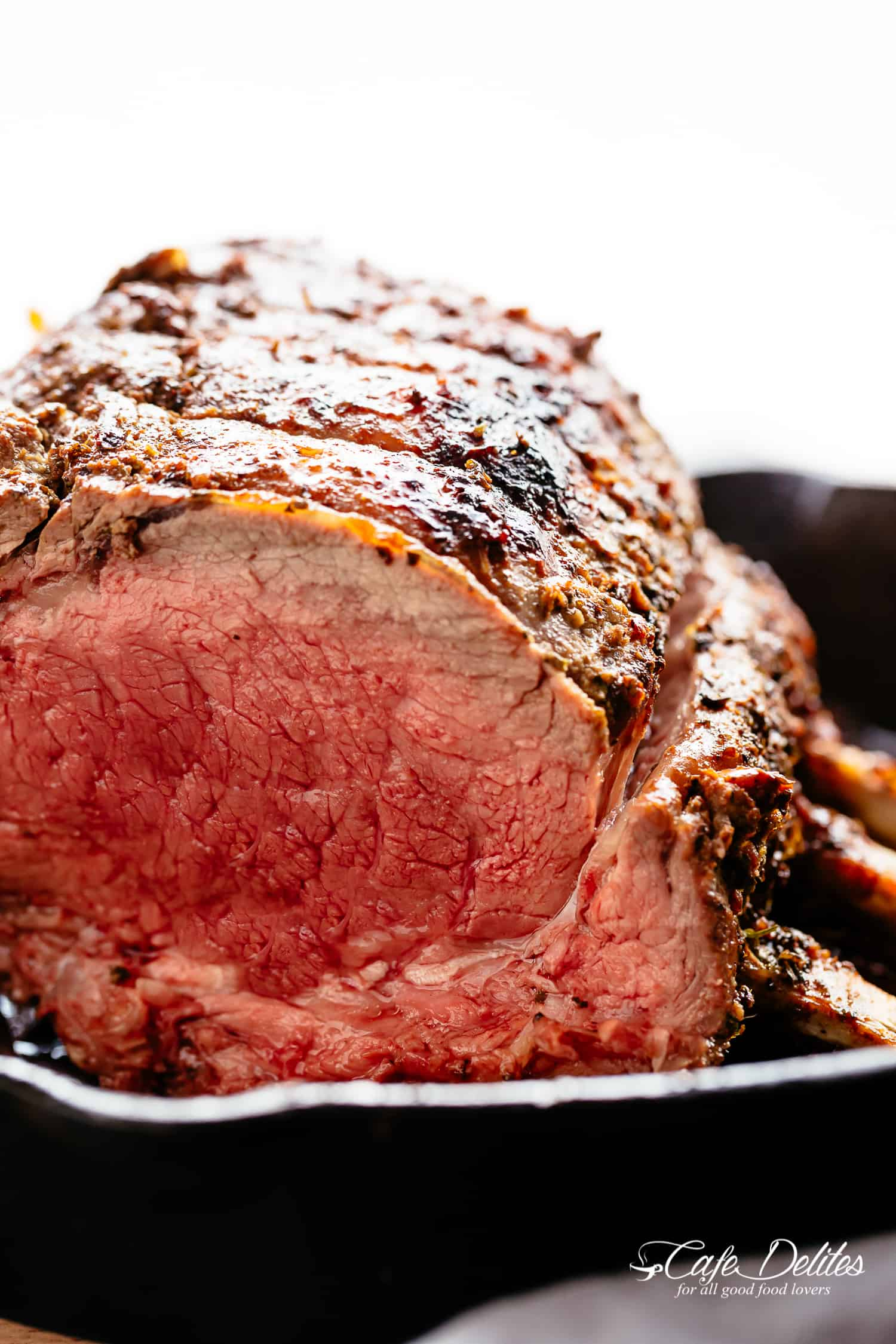 Prime Rib Roast full of flavour garlic butter and herbs! | https://cafedelites.com
