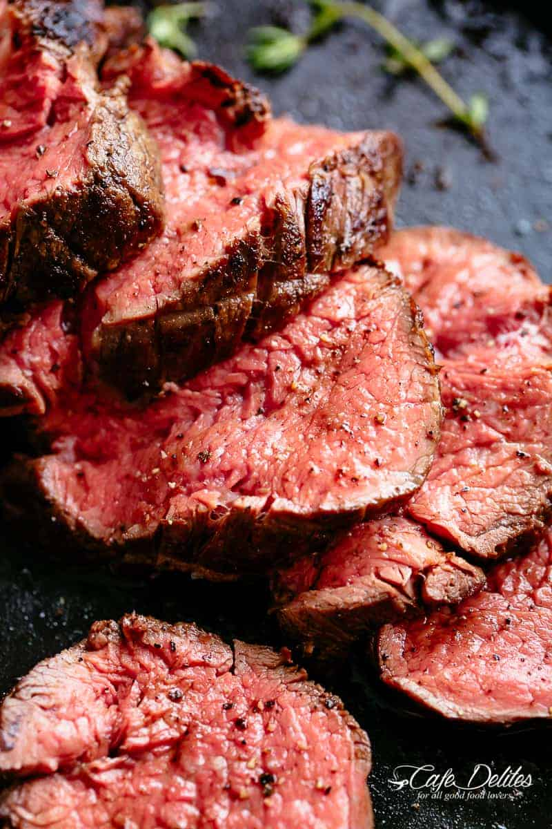 The best, juicy roast Beef Tenderloin slathered with garlic butter that melts in your mouth with every bite! Even better when served with a rich and rustic, easy to make red wine sauce (or jus) | cafedelites.com