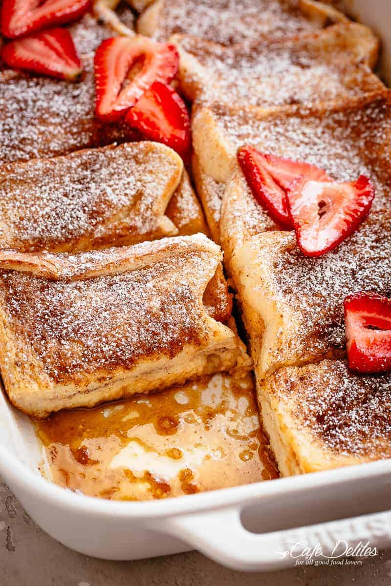 French Toast Casserole with a cinnamon brown sugar syrup is a decadent spin on a classic breakfast recipe! | cafedelites.com