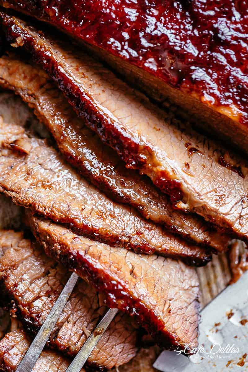 Juicy Beef Brisket cooked low and slow until tender, basted in a mouthwatering barbecue sauce with a kick of garlic and optional heat! | cafedelites.com