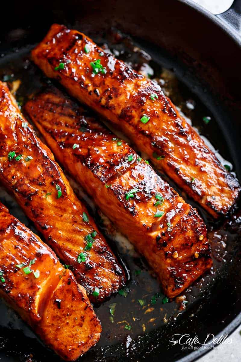 Firecracker Salmon recipe with an incredible sauce is an easy to make dinner in minutes! Flakey and tender on the inside with crispy edges. | cafedelites.com