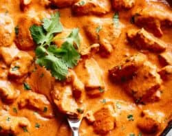 A super easy, full flavoured Butter Chicken with aromatic golden chicken pieces in an incredible curry sauce. | cafedelites.com