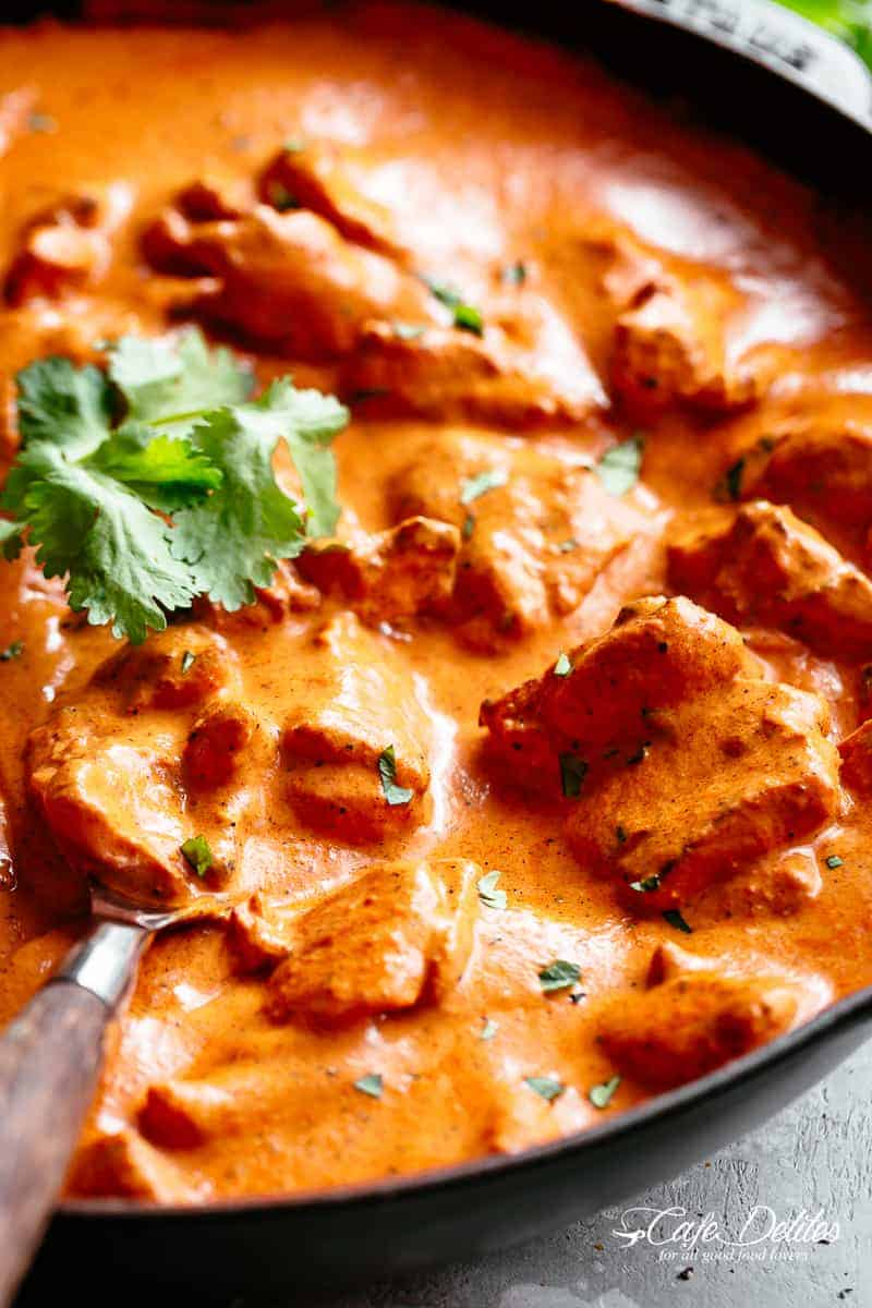 A super easy, full flavoured Butter Chicken recipe with aromatic golden chicken thigh or breast pieces in an incredible curry sauce. | cafedelites.com