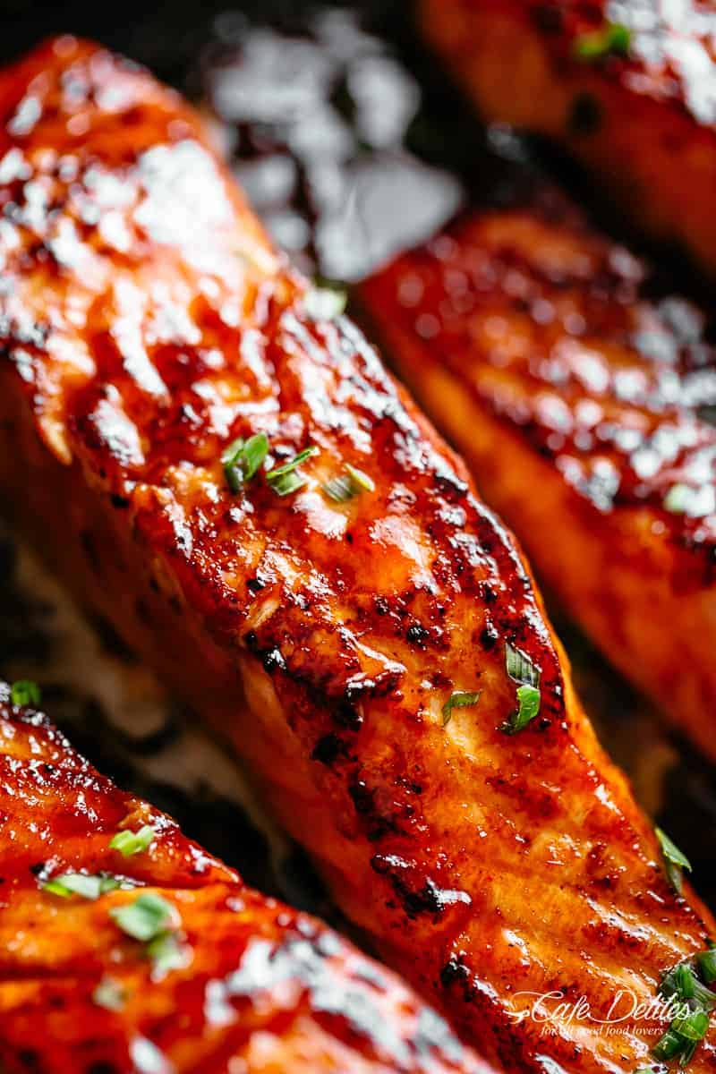 Firecracker Salmon recipe with an incredible sauce is flakey and tender on the inside with crispy edges. | cafedelites.com