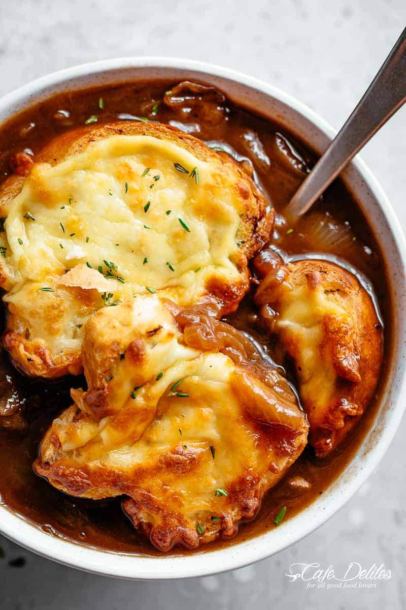 Classic French Onion Soup finished off with garlic bread and two types of melted cheese | cafedelites.com