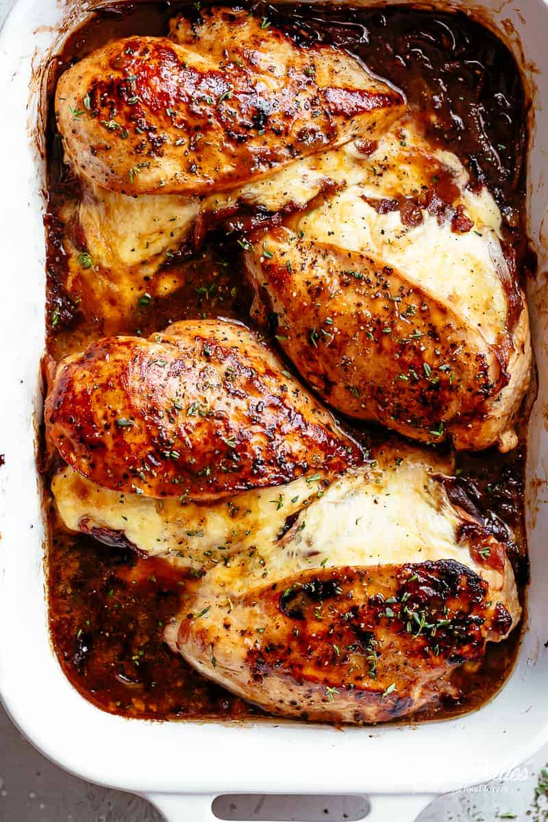 French Onion Stuffed Chicken Casserole makes for a delicious dinner! Juicy, succulent chicken breasts stuffed with caramelized onions and glorious melted cheese. | cafedelites.com