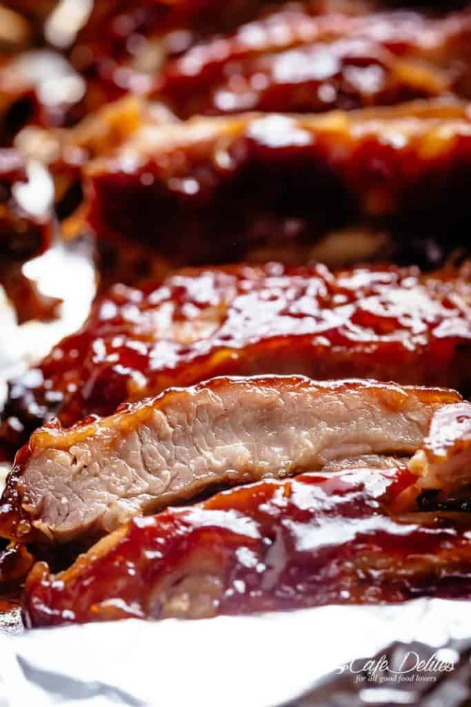 Slow Cooker Ribs slathered in the most delicious sticky barbecue sauce with a kick of garlic and optional heat! Juicy melt-in-your-mouth oven baked Barbecue Pork Ribs are fall-off-the-bone delicious! Double up on incredible flavour with an easy to make dry rub first, then coat them in a seasoned barbecue sauce mixture so addictive you won't stop at one! Finger licking good ribs right here! | cafedelites.com