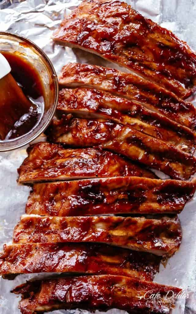 Crock Pot Ribs slathered in the most delicious sticky barbecue sauce with a kick of garlic and optional heat! Juicy melt-in-your-mouth oven baked Barbecue Pork Ribs are fall-off-the-bone delicious! Double up on incredible flavour with an easy to make dry rub first, then coat them in a seasoned barbecue sauce mixture so addictive you won't stop at one! Finger licking good ribs right here! | cafedelites.com