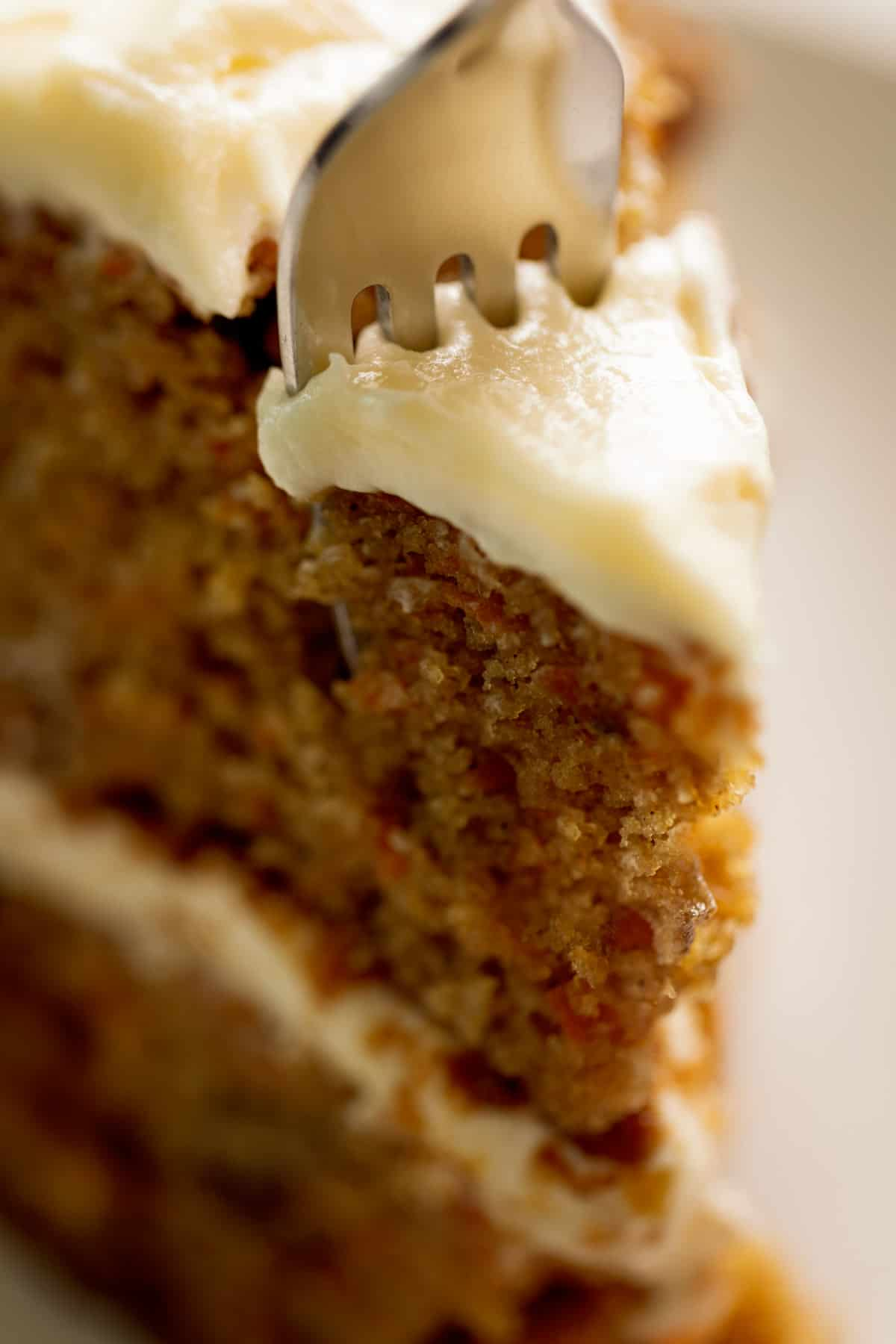 A slice of soft carrot cake | cafedelites.com