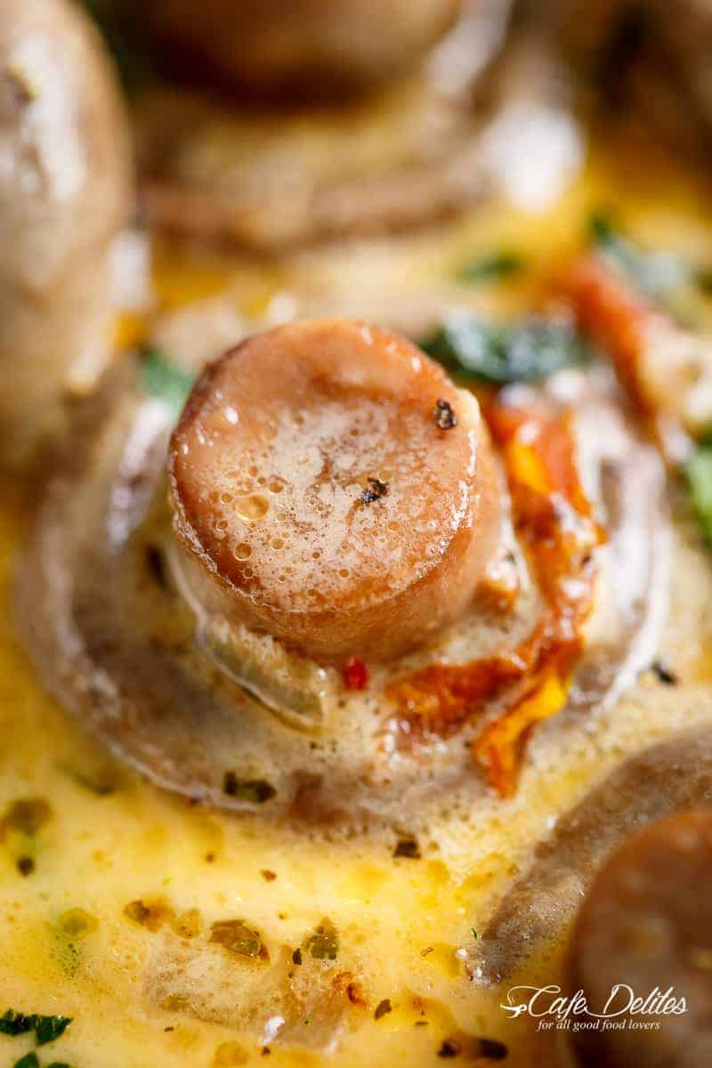 Creamy Garlic Butter Tuscan Mushrooms in a rich sauce filled with garlic, sun dried tomatoes, parmesan cheese and spinach. KETO and LOW CARB! | cafedelites.com