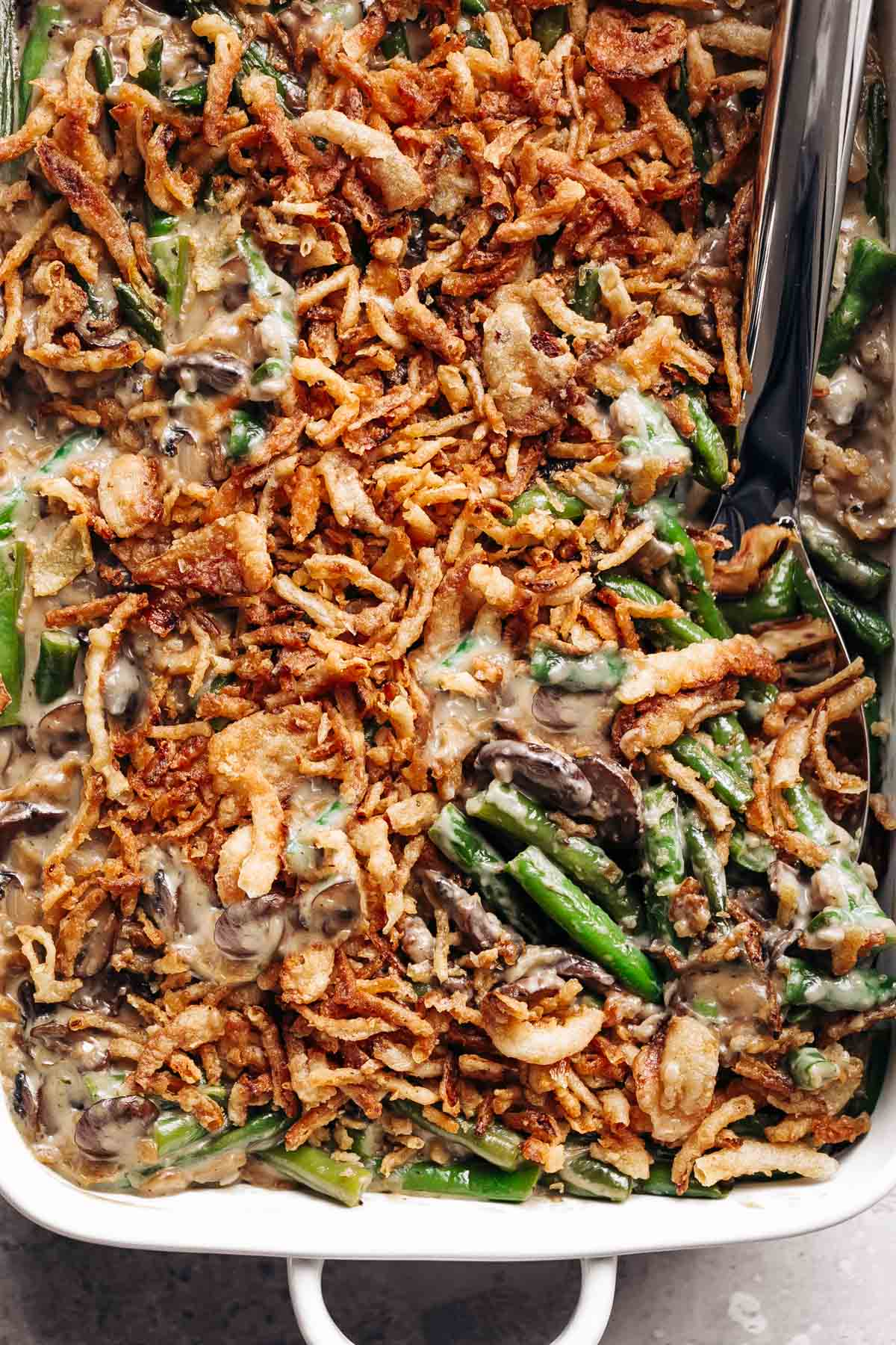 Green Bean Casserole with homemade cream of mushroom soup and French fried onions!
