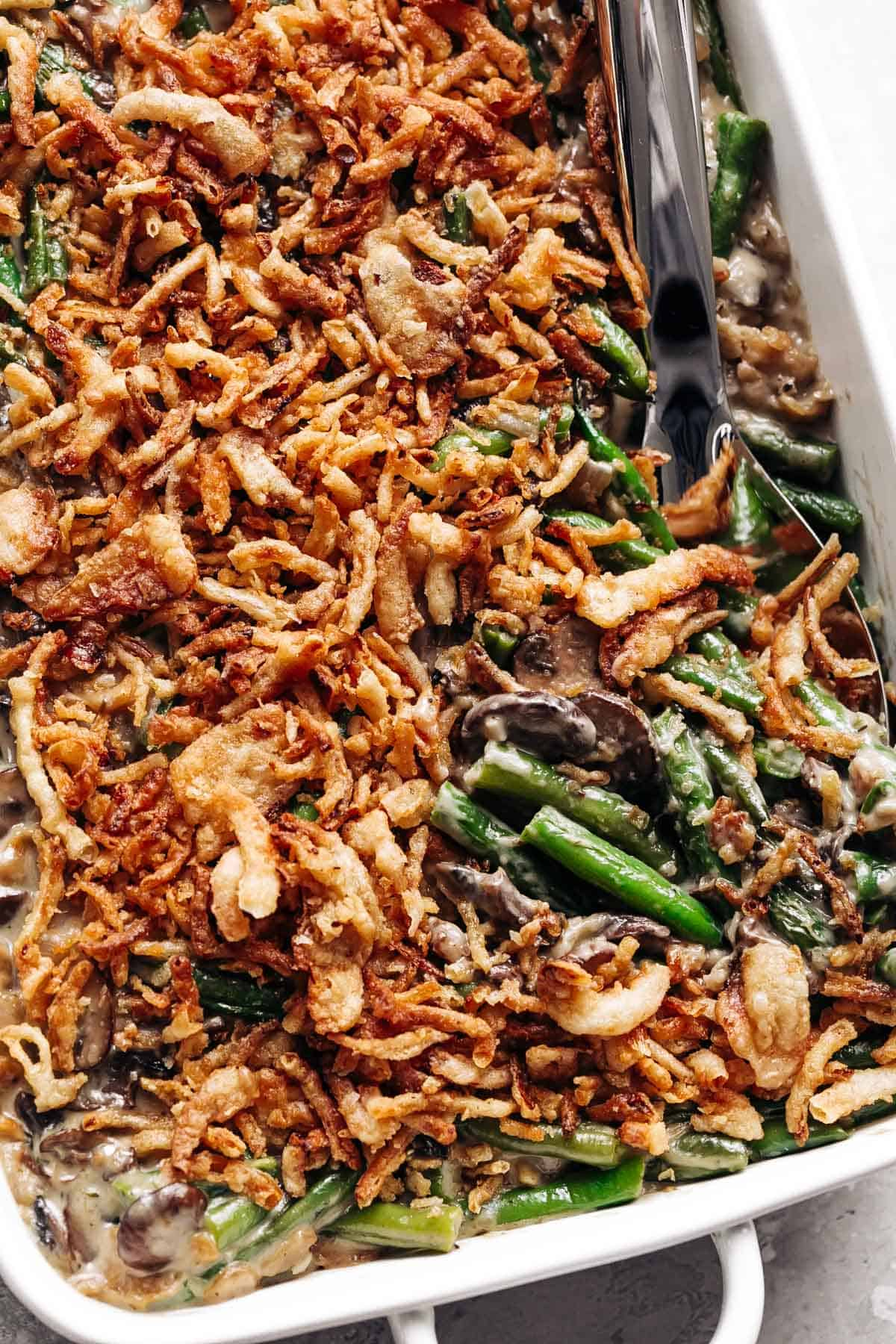 A ladle of green bean casserole fresh out of the oven!